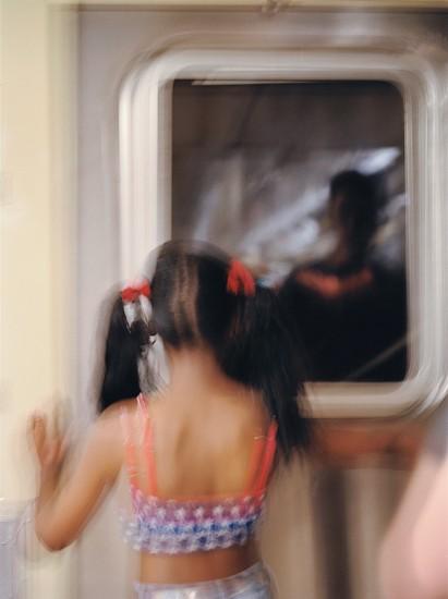 Machiel Botman, Subway Girl, New York 2002, Chromogenic color print